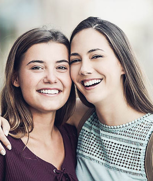 Two Young Woman Smiling Cosmetic Dentistry Berthoud CO
